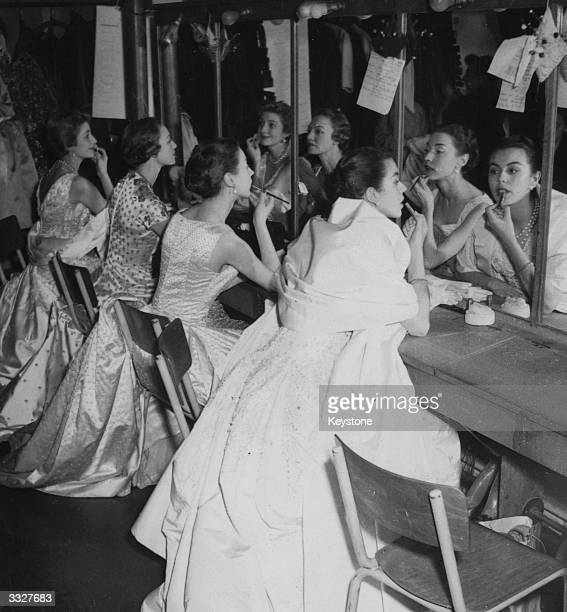Models finish their make up in preparation for a fashion preview by Christian Dior in Paris