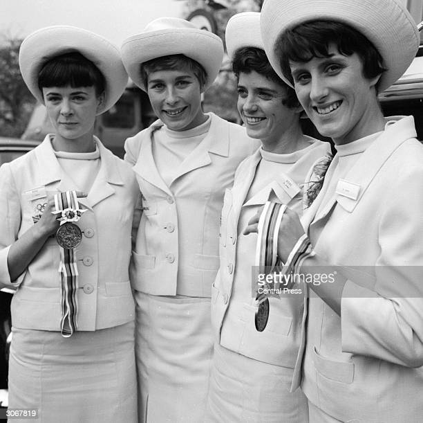Members of the British Olympic Relay Team Janet Simpson Mary Rand Daphne Arden and Dorothy Hyman set off from London Airport to Buckingham Palace to...