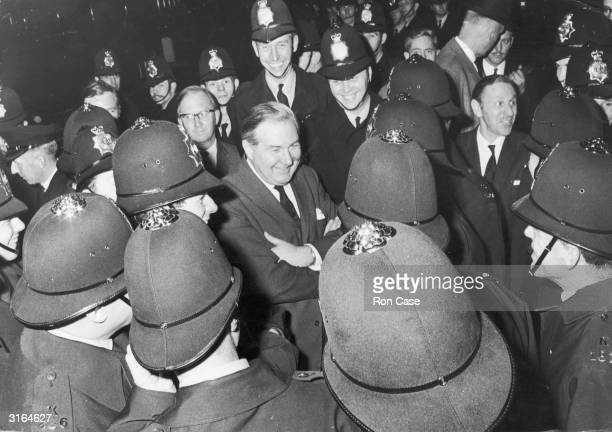Home Secretary James Callaghan surrounded by police during an anti-Vietnam demonstration outside the US Embassy.