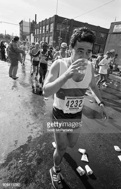 New York A runner takes a break and drinks water at the 10 mile mark in Williamsburg Brooklyn during the NYC Marathon