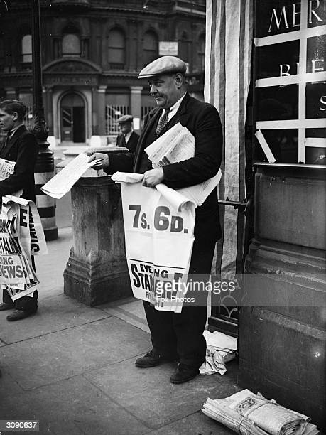 An Evening Standard newspaper vendor displays a poster announcing a rise in income tax which will be announced in the Budget.