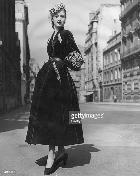 'Prince Igor' a Christian Dior design of full skirted green velvet coat with tight belt gold and silver embroidery over slant pockets and deep...