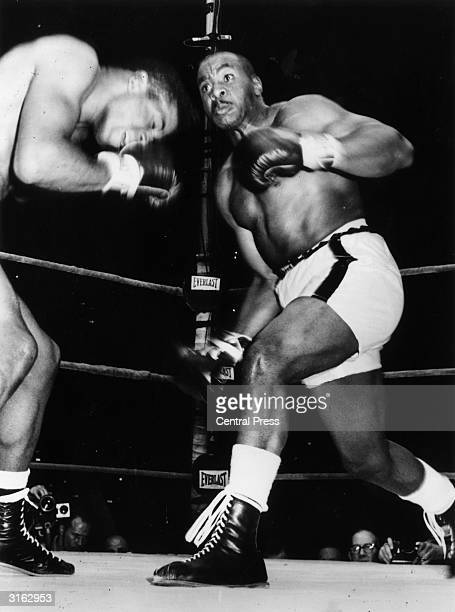 American boxers Floyd Patterson and Sonny Liston during the first round of their fight in Chicago Illinois Liston went on to win the match after just...