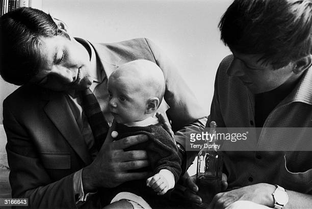 'Blue Peter' presenters Peter Purves and John Noakes pose with 14weekold Daniel Simon Scott who will star with them in a special feature on babies