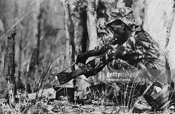 A Kammussaquele soldier boiling water during a break from his patrolling of rebel activities in the Portuguese territory of southern Angola