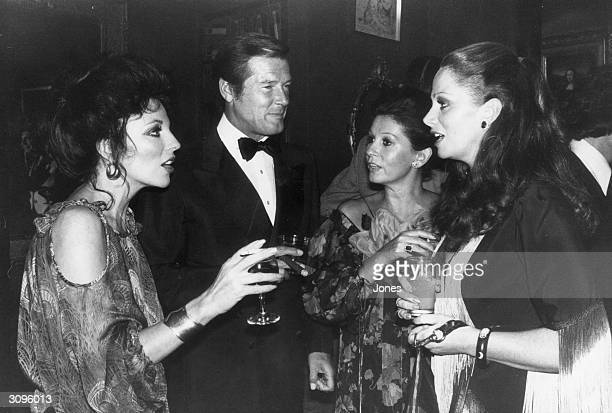 British actress Joan Collins writer Jackie Collins actor Roger Moore and his wife Luisa Mattioli at a party celebrating the release of 'The Stud' a...