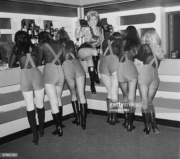 27yearold landlady Linda CoulterBrown poses with six of her barmaids at the 'Bird's Nest' a new Railway pub in West End Lane northwest London 10th...