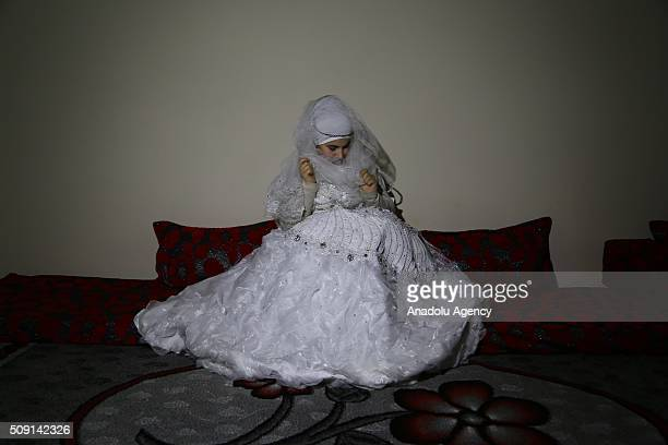 27yearsold Syrian refugee Hatija Ahdiy fled from Syria due to ongoing civilwar poses with her wedding dress at a house in Turkey's Syrian border city...