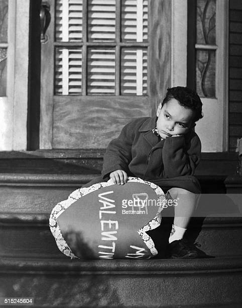 2/8/1949New York New York Picture shows little Johhny McBride seated on the steps of his sweetheart's after trying to deliver her a valentine