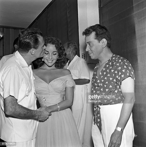 2/8/1957Acapulca Mexico With Mexican comedian Mario Morenolooking on at right producer Mike Todd plants a kiss on the eyebrow of his bride Elizabeth...