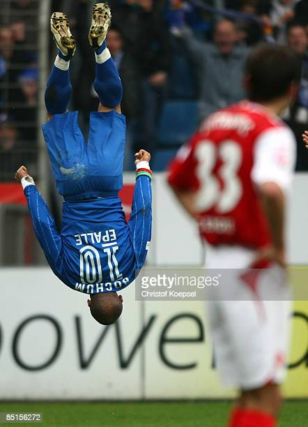 Joel Epalle of Bochum celebrates his first goal and Mario Cvitanovic of Cottbus looks dejected during the Bundesliga match between VfL Bochum and FC...