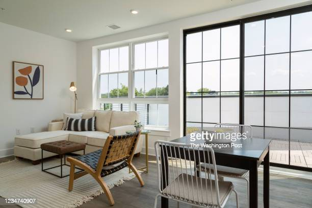 Living area with Doors to Roofdeck in Unit 502 at The Archie on July 28, 2021 in Washington DC.