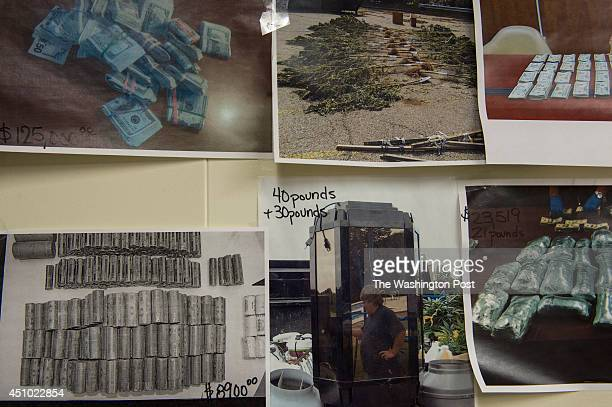 Pictures of cash and seized marijuana are taped to a wall at the Drug Enforcement Agency in Weirton West Virginia on April 29 2014 While many states...