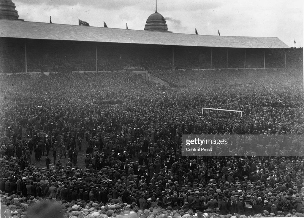 A massive crowd is forced onto the pitch by sheer weight of numbers at the FA Cup Final between Bolton Wanderers and West Ham United. Bolton won the first ever FA Cup final to be played at the newly completed Wembley Stadium with a 2-0 victory. An estimated 200, 000 people attended tha match.