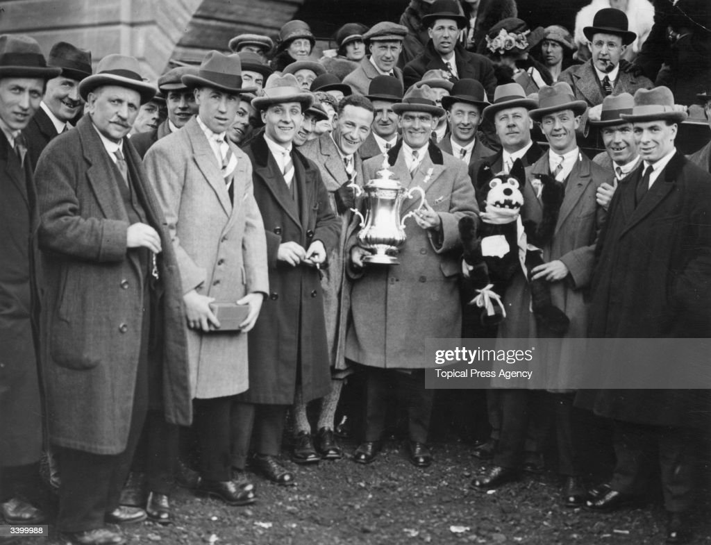 Bolton Wanderers team captain Joe Smith holds the FA Cup trophy outside the stadium after the match. Bolton Wanders beat West Ham United 2-0 in the first FA Cup final to be held at the newly completed Wembley Stadium.