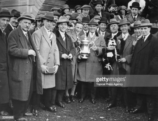 Bolton Wanderers team captain Joe Smith holds the FA Cup trophy outside the stadium after the match Bolton Wanders beat West Ham United 20 in the...