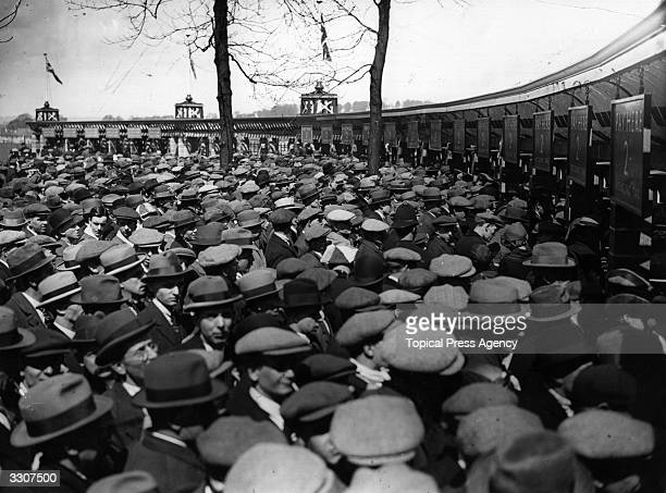 Crowds at the turnstiles before the FA Cup Final between West Ham United and Bolton Wanderers at Wembley Stadium. It was the first final to be held...