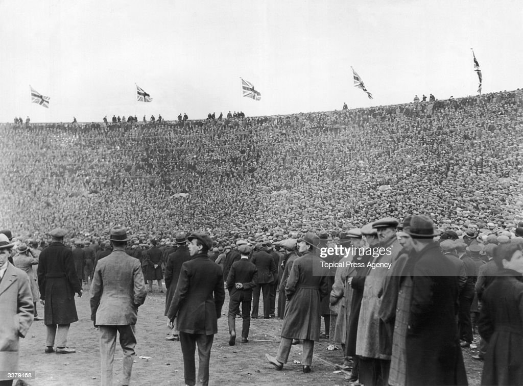 The unexpectedly huge attendance forces spectators onto the pitch before the first ever FA Cup Final to be held at the newly opened Wembley Stadium. The FA Cup itself was won by Bolton Wanderers with a 2-0 victory over West Ham United.