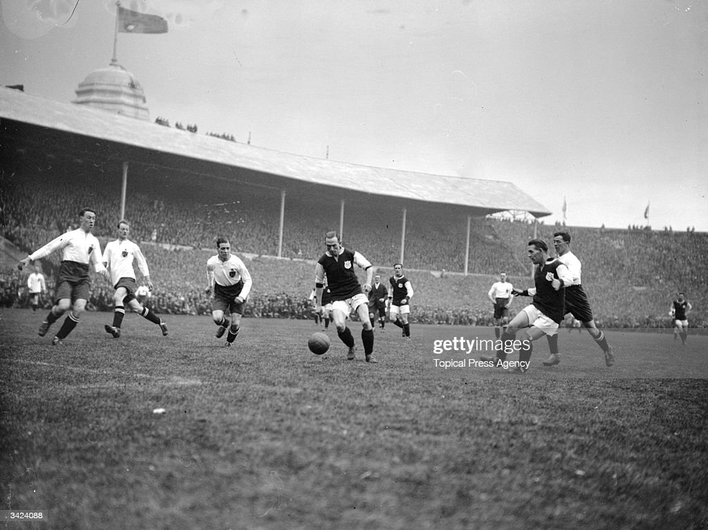 West Ham United's Moore receives a pass from team mate, Ruffell in the first ever FA Cup final to be played at Wembley Stadium. West Ham United went on to lose the match 2-0 to Bolton Wanderers.