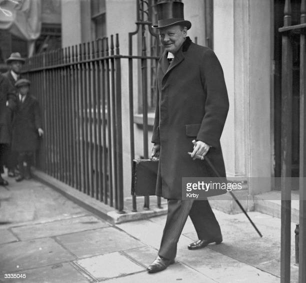 Chancellor of the Exchequer Winston Churchill leaves 11 Downing Street London on his way to present the budget