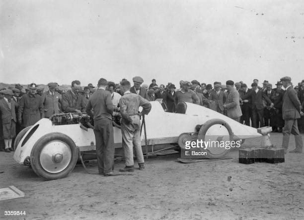 Mechanics making adjustments to J G Parry Thomas' 'Babs' at Pendine Sands, where he beat the world record travelling at a speed of 172 mph for the...