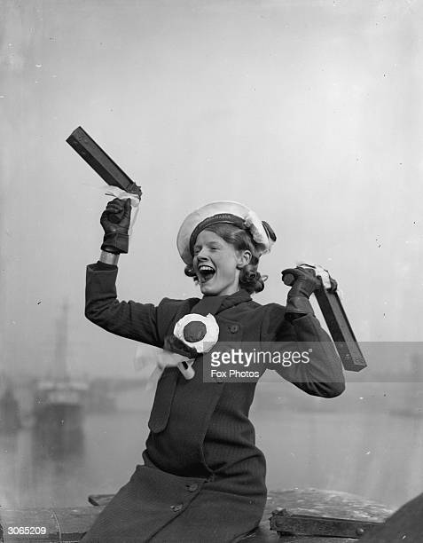 A Portsmouth football fan with a rattle in each hand cheering for her team before their FA Cup final against Manchester City which the latter won 21