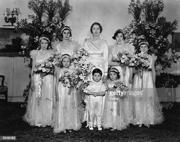 Miss Hester Irene Copper with her bridesmaids on her wedding day Miss Copper will marry Colin Charles Rutherford Bridesmaids are Betty Pais Joy...