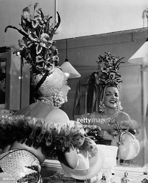 Singer and dancer Carmen Miranda in her dressing room at the London Palladium The characteristically ornamented star is appearing in London for the...