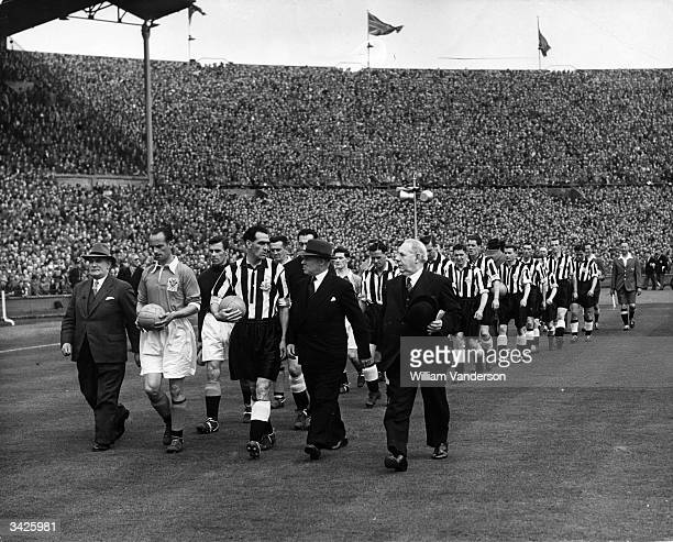 Captains Johnston and Joe Harvey lead out Blackpool and Newcastle United FC for the 1951 FA Cup final at Wembley Stadium Newcastle won the match 20...