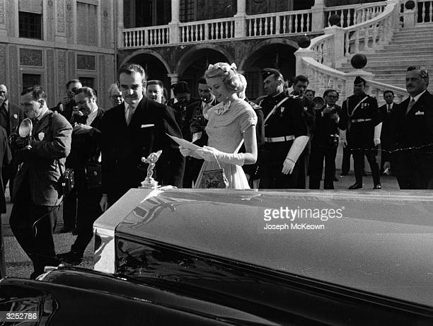 Prince Rainier III of Monaco with Grace Kelly receiving the car as a wedding gift from the people of Monaco the day before their marriage ceremony...