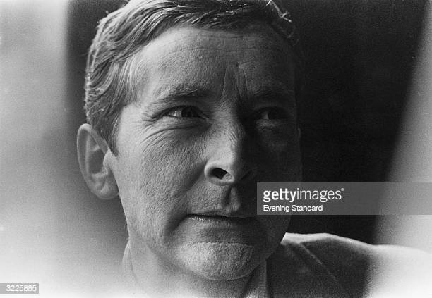 Comedian and actor Kenneth Williams narrowing his eyes in a scowl