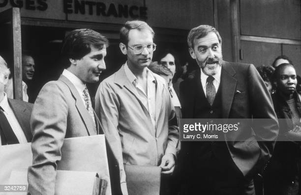 Criminal defendant Bernhard Goetz the 'subway shooter' talks to his attorneys Mark Baker and Barry Slotnick outside the courthouse during his trial...
