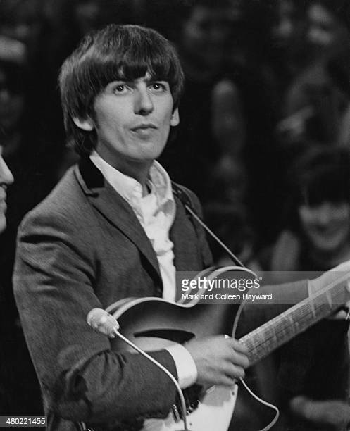 George Harrison from The Beatles performs on The 'Around The Beatles' TV special at Rediffusion's Wembley Studio in London on 28th April 1964
