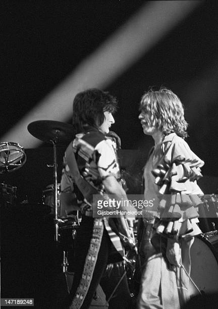 Mick Jagger and guitarist Ron Wood from The Rolling Stones perform live on stage at the Festhalle in Frankfurt Germany on April 28 1976 as part of...