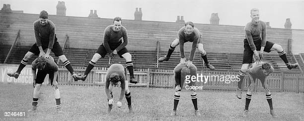 Luton Town FC footballers in training Jumping from left to right Harkins GOrdon Clarke and Moir Bending from left to right Wolstenholme Black Dennis...