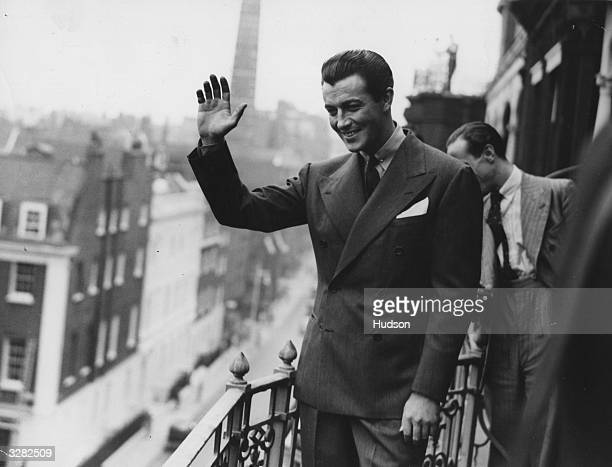 Robert Taylor the screen name of Spangler Arlington Brugh the American leading man who was contracted to Metro Goldwyn Mayer visiting London and...