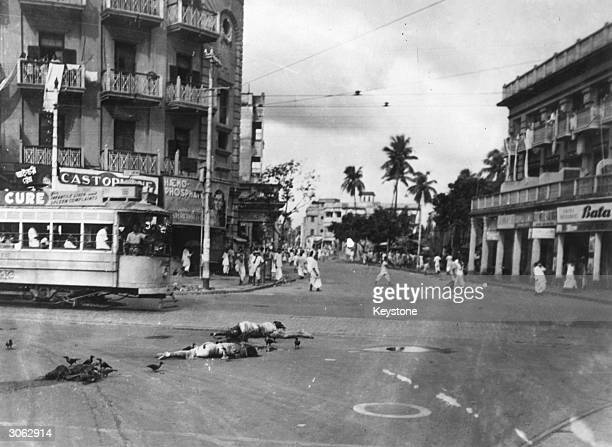 Birds flock round dead bodies lying at crossroads after riots in Bhowanipore south Calcutta a predominantly Hindu and Sikh locality where Muslim...