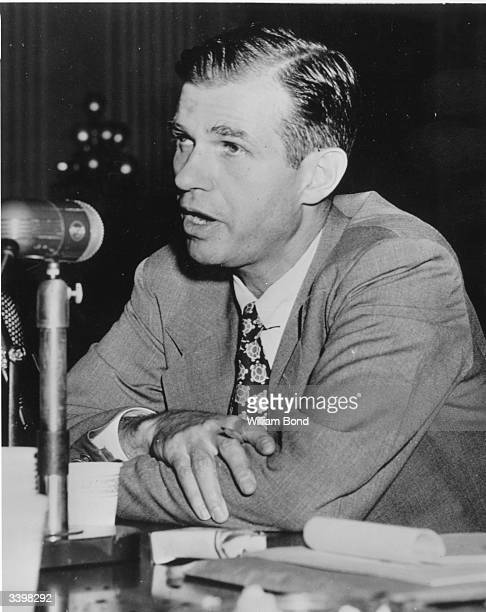 American State Department official Alger Hiss denying he was a member of a Communist cell before the House Committee on UnAmerican Activities in...