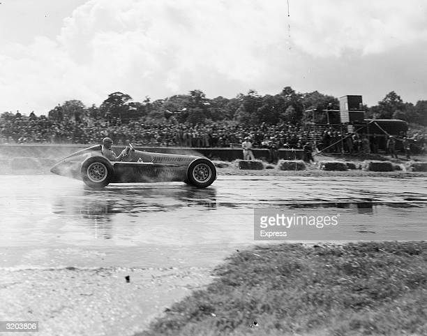 Argentinian racing driver Juan Manuel Fangio rounding Stowe corner in his AlfaRomeo during the International Trophy Race at Silverstone