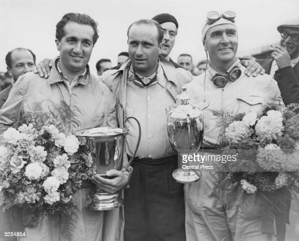 Racing drivers Alberto Ascari of Italy, Juan Manuel Fangio of Argentina and Giuseppe Farina of Italy, who won the Grand Prix at Silverstone.