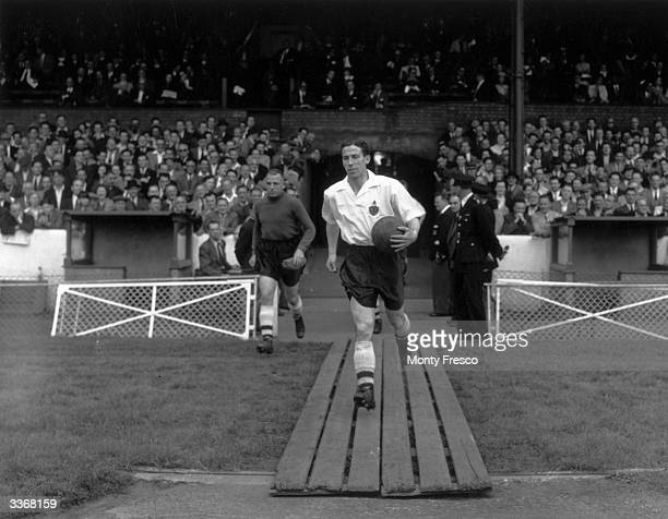 Bolton Wanderers captain Billy Moir leads his team out for a match against Chelsea at Stamford Bridge in London