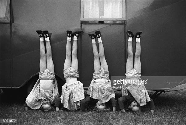 The Good quadruplets Frances Elizabeth Jennifer and Bridget are standing on their heads on a visit to a fair in Bristol Original Publication Picture...