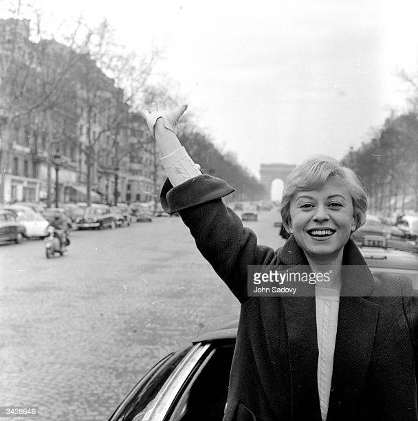 Italian film actress Giulietta Masina arrives in Paris and pays a visit to the Arc de Triomphe