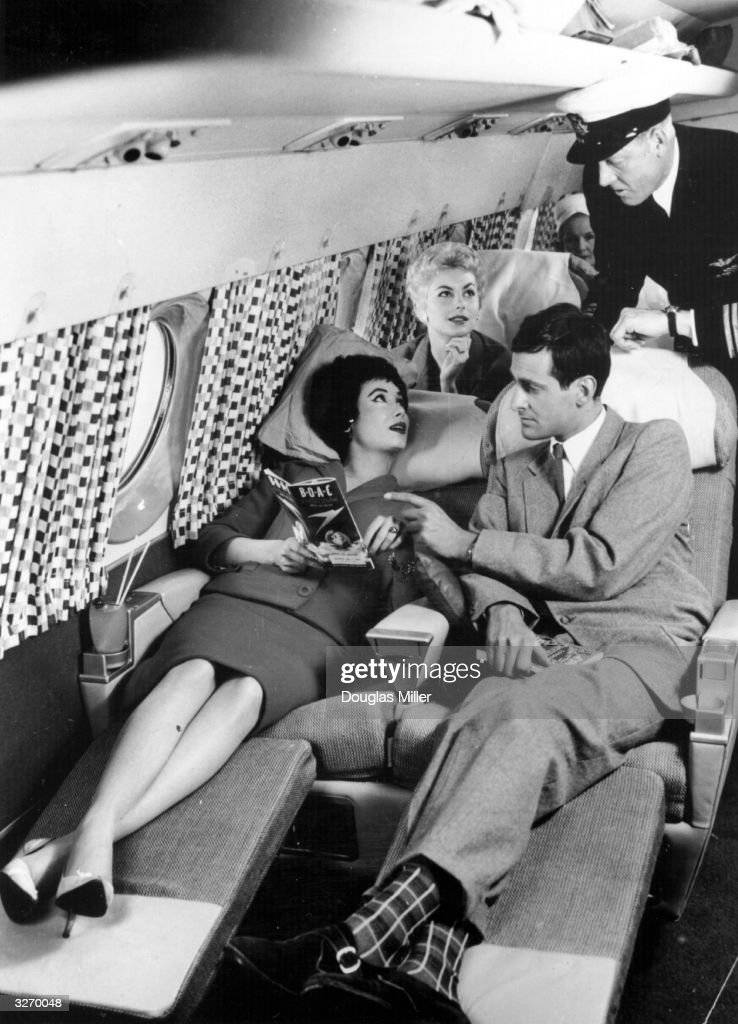 Passengers relaxing on the sleeper seats in the new Comet 4 during a demonstration flight at Hatfield. The plane, which is fitted out in accordance with an interior decor scheme designed for BOAC aircraft by Gaby Schreiber, flew from New York to London in under six and a half hours.