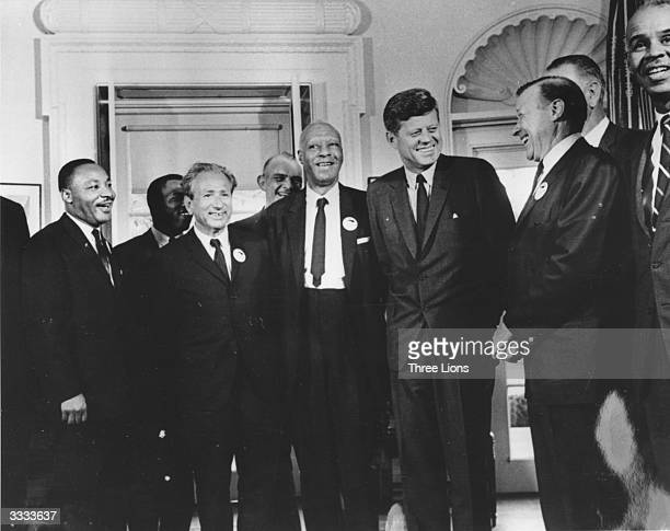American president John F Kennedy in the White House with leaders of the civil rights 'March on Washington' Whitney Young Dr Martin Luther King Rabbi...