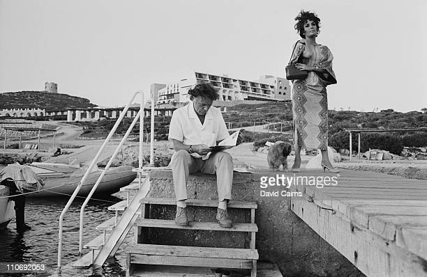 Actor Richard Burton with his wife actress Elizabeth Taylor on Capo Caccia in Sardinia during the filming of 'Goforth' later titled 'Boom'
