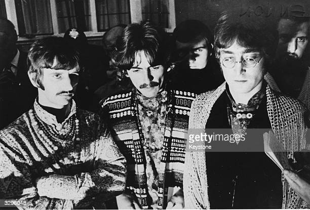 Three of the Beatles Ringo Starr George Harrison and John Lennon in Bangor North Wales They have just been informed of the death of their former...