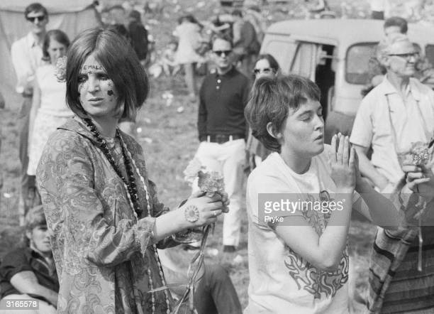 Two young women wearing jewellery and face paint at a Festival of Flower Children held in Woburn Park seat of the Duke of Bedford