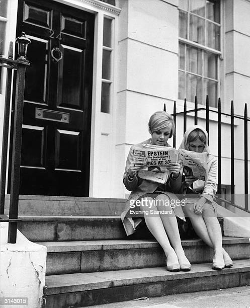 Young Beatles' fans reading the news of Brian Epstein's death on the steps of the Beatles' manager's home in Belgravia London