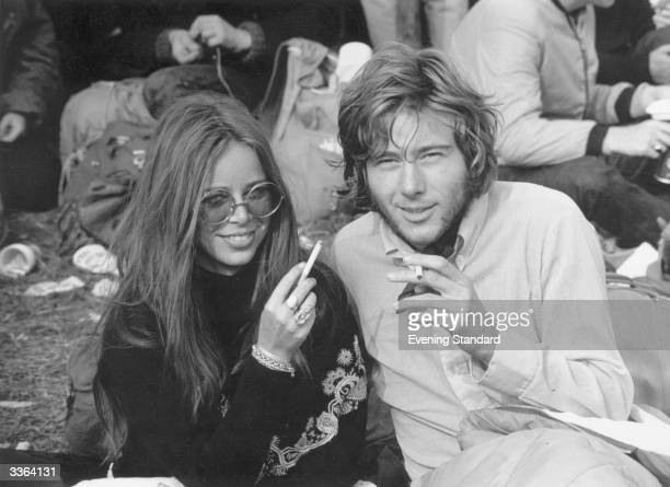 Friends enjoying a cigarette during the Isle of Wight Pop Festival.